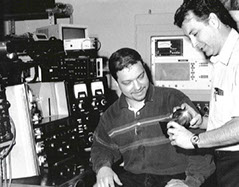Joining Technologies Founder Michael Francoeur (right) studies a component with a colleague.