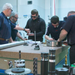 Machine shop technicians inspect a component at Joining Technologies.