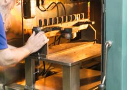 Electron beam welding technician preparing a vacuum chamber.