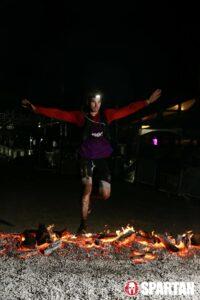 man crosses hot coals during Spartan race